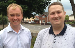 Local campaigner Mathew Hulbert with Tim Farron