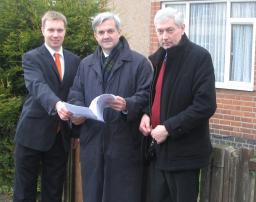 Michael Mullaney, Chris Huhne MP and Michael Gould outside the site of the planned Barwell Community House