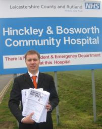 Michael Mullaney with copies of the NHS survey outside Hinckley and Bosworth Community Hospital