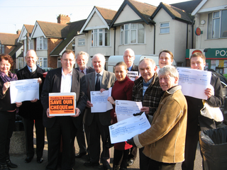 Attached; Picture of Hinckley and Bosworth Liberal Democrat councillors and campaigners with the 2,500 petitions they have collected to save the cheque.