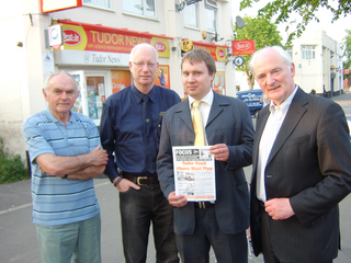 Lib Dem Councillors, David Bill, Dave Cope, Michael Mullaney and Don Wright at the site of the proposed mast on Tudor Road, Hinckley, with a copy of the petition and showing the markings where the planned mast is to go.
