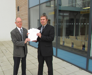 Cllrs Bill Crooks and Michael Mullaney submit the petition against plans to build 450 houses in Barlestone and Osbaston
